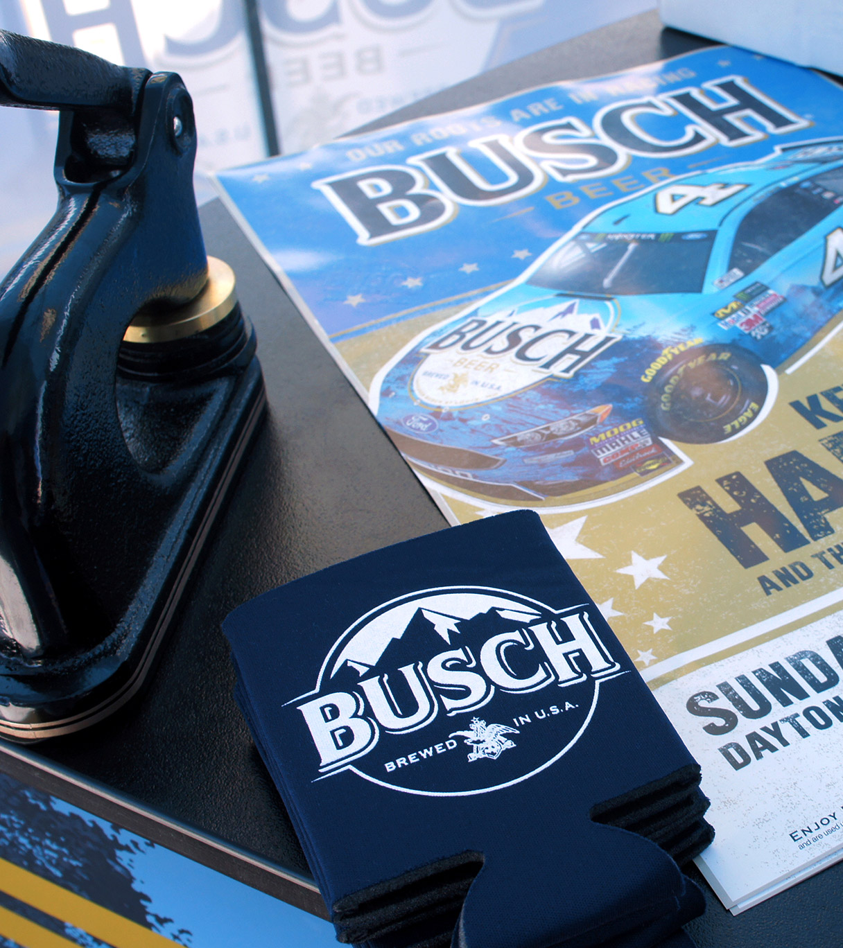 Busch beer coozie and poster