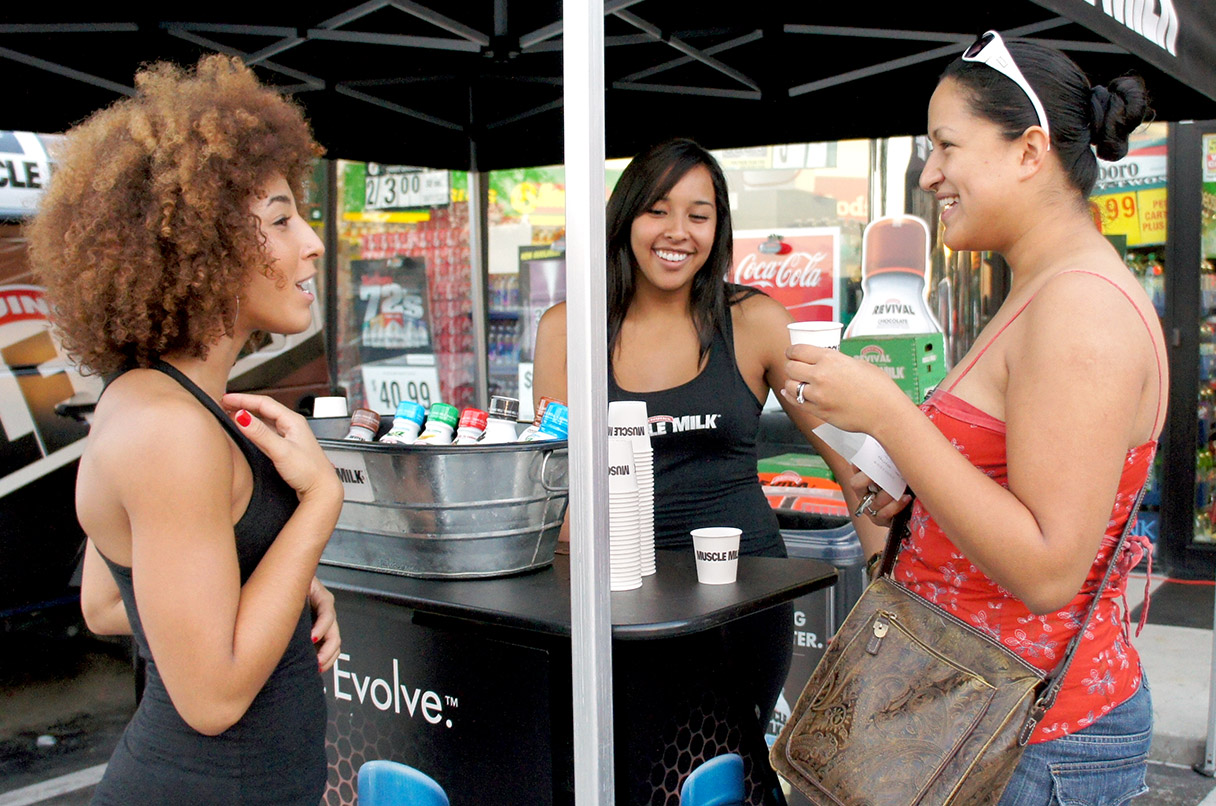 Muscle Milk brand ambassadors sampling product
