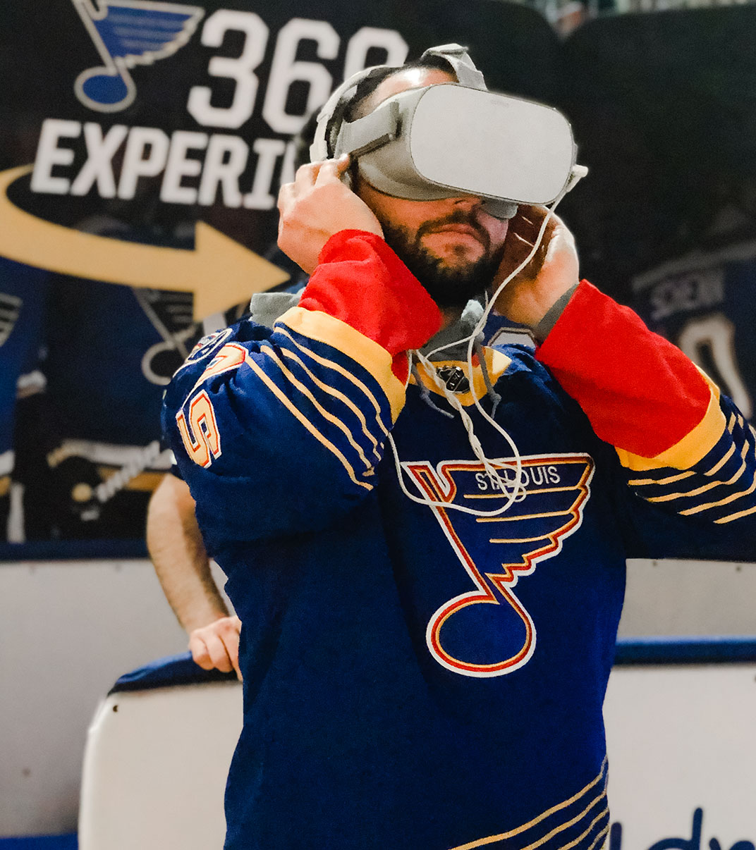 Man in St. Louis Blues Jersey in VR headset at Blues 360 Experience